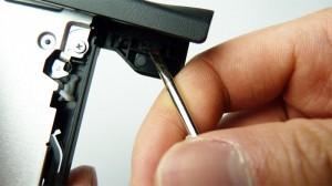 Push horizontal left clip inwards and forwards.