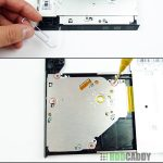 Removing bezel from optical drive